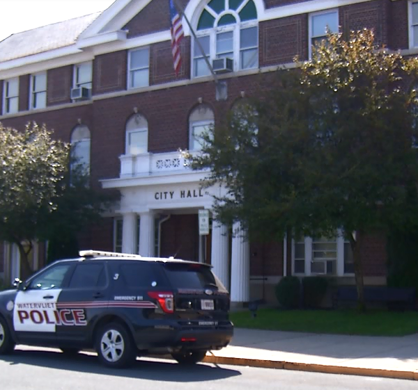 Watervliet city hall with a police car