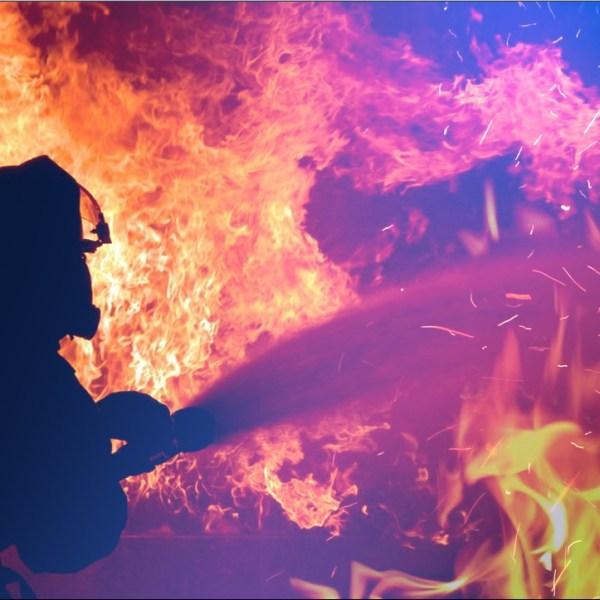 Firefighter against blaze
