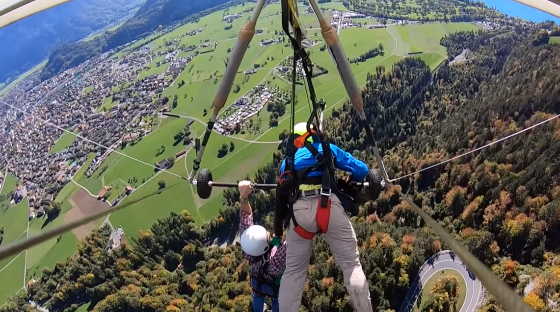 Terrifying video shows man dangling from hang glider on flight gone
