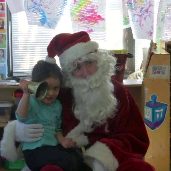 Santa reads with students at Unity House's A Child's Place