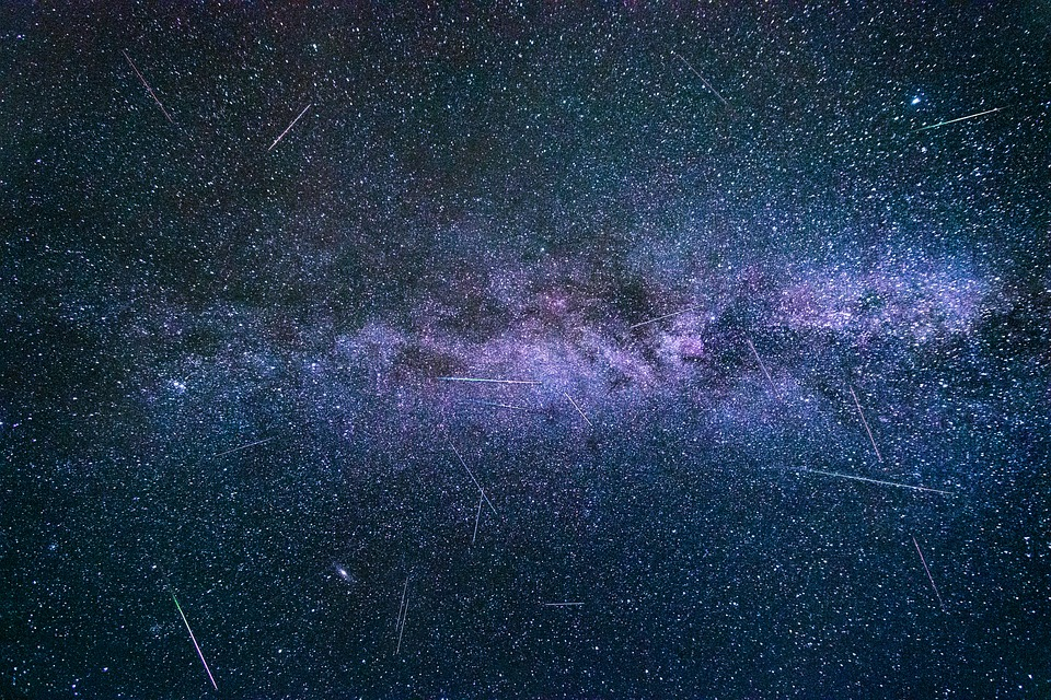 Perseids in a starry sky against the Milky Way
