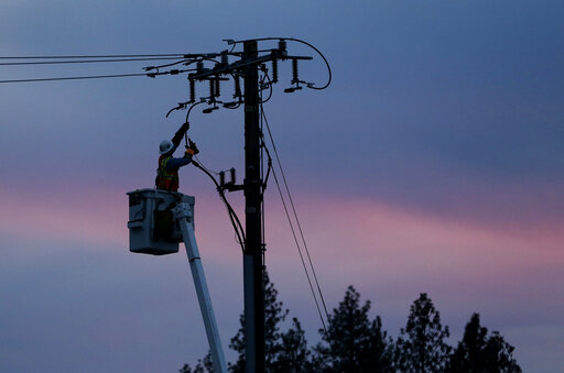 lineman repairing power lines