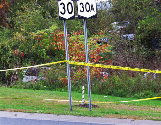 road signs wrapped in caution tape