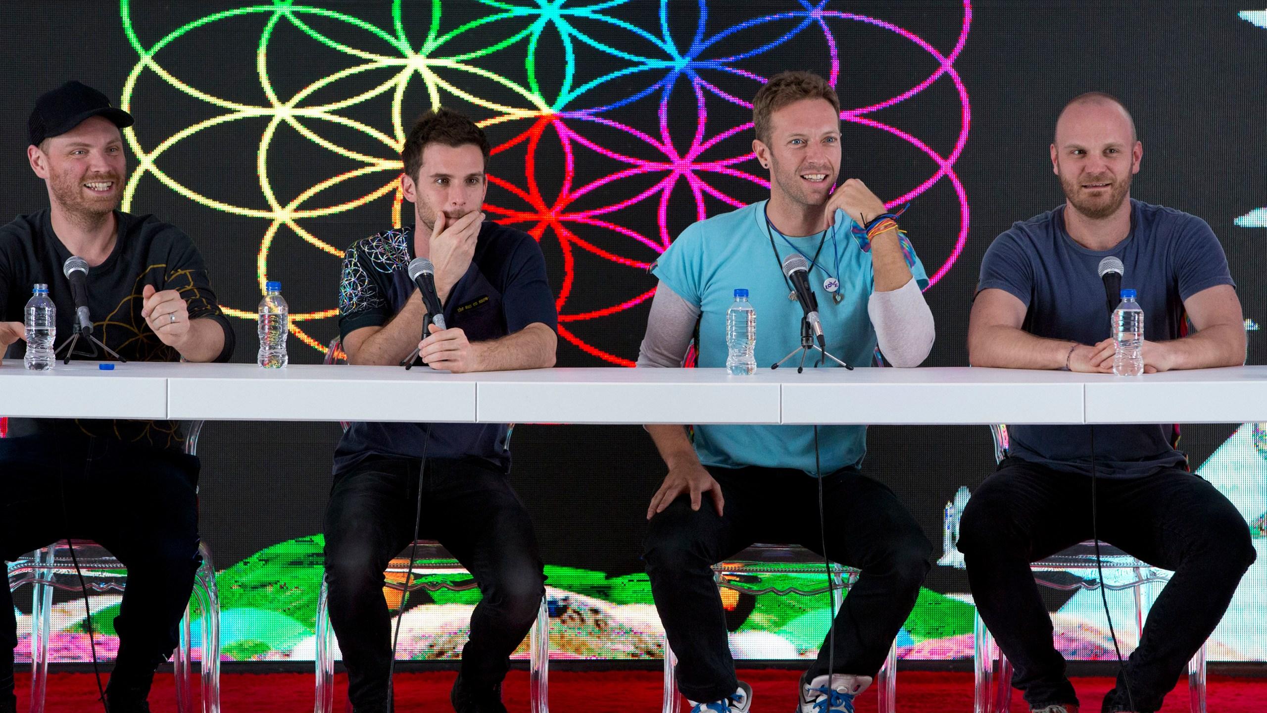 Jonny Buckland, Guy Berryman, Chris Martin, Will Champion