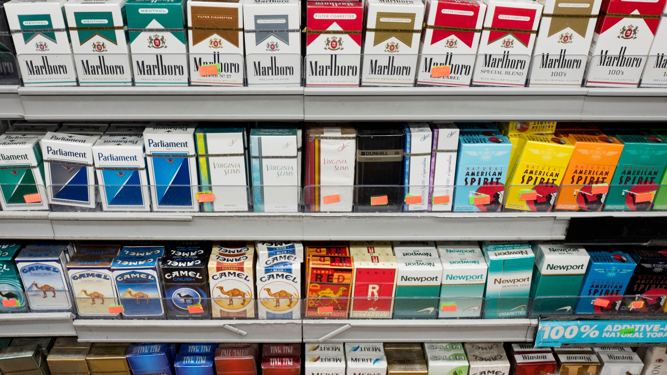 A wall of tobacco products behind the counter