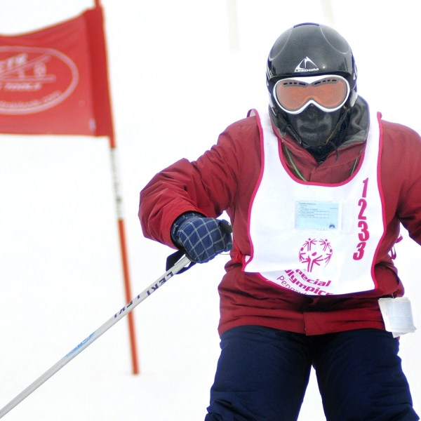 bundled up skier in special olympics event