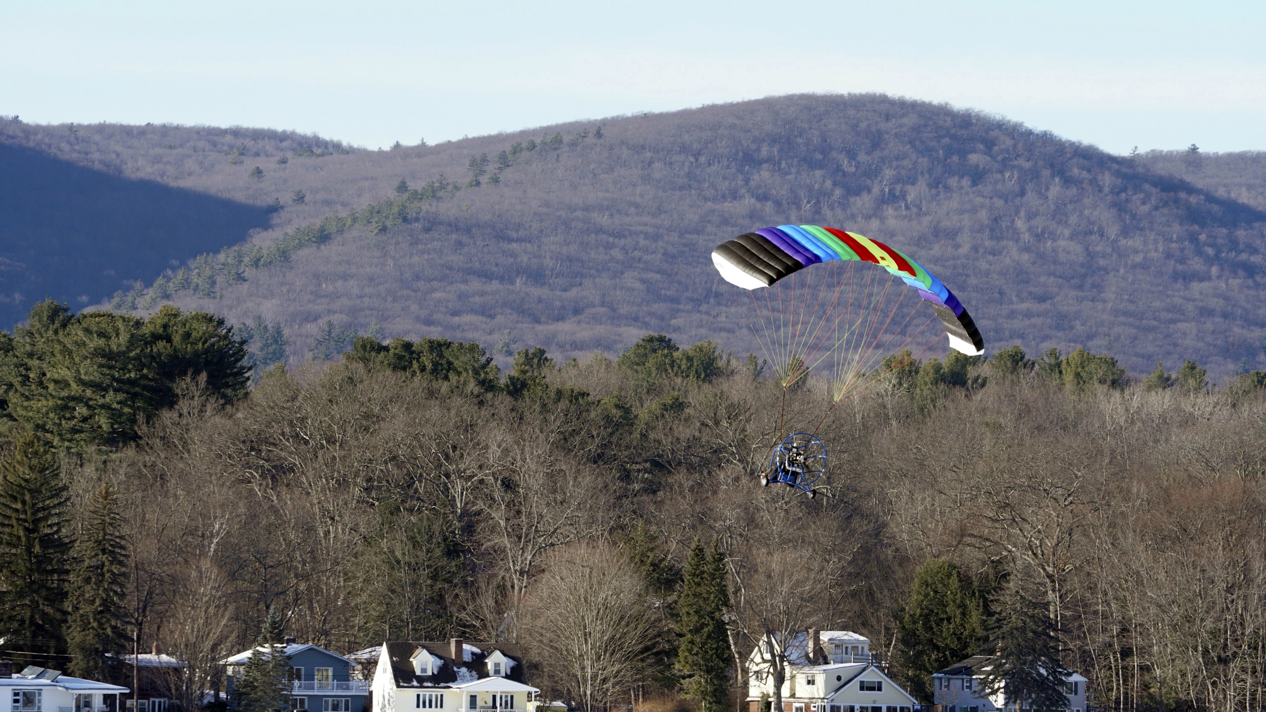 Parachute over winter lake in Mass