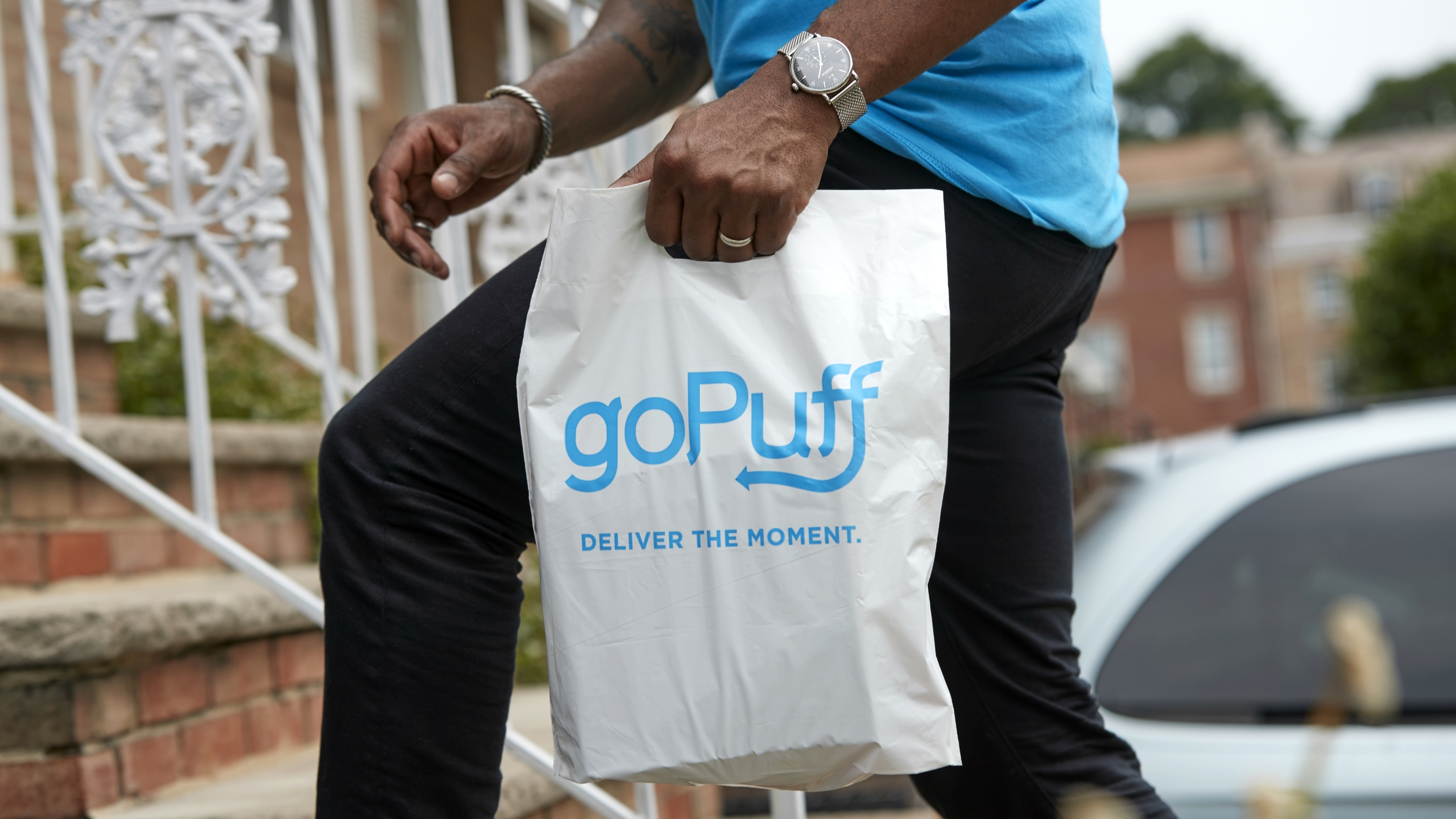 A GoPuff delivery arrives on the front steps