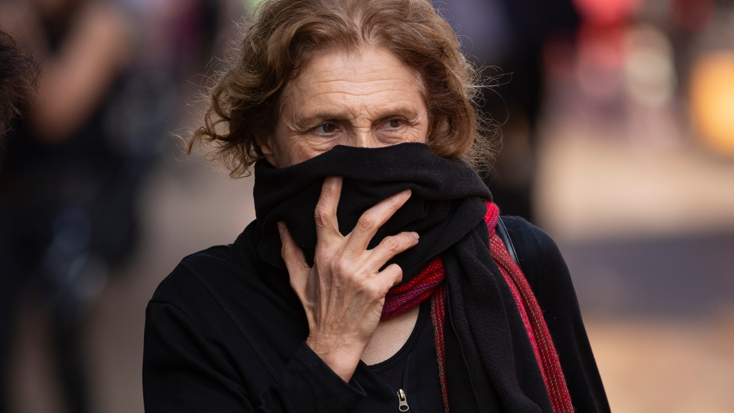 Woman covers face with scarf