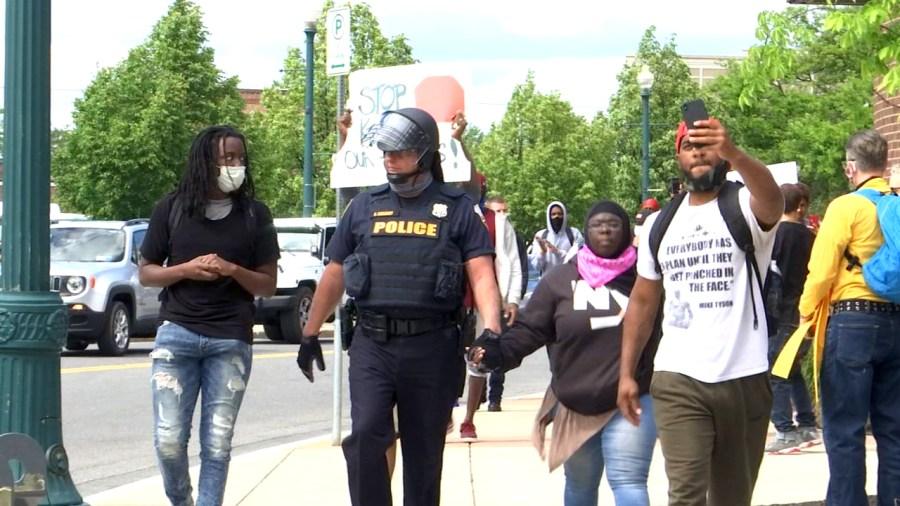 Solidarity: Schenectady police and demonstrators walking hand in hand