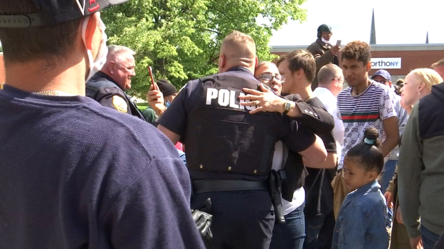 Solidarity: Schenectady police and demonstrators hug.