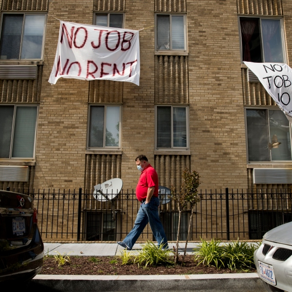 No job, no rent sign hanging from an apartment window