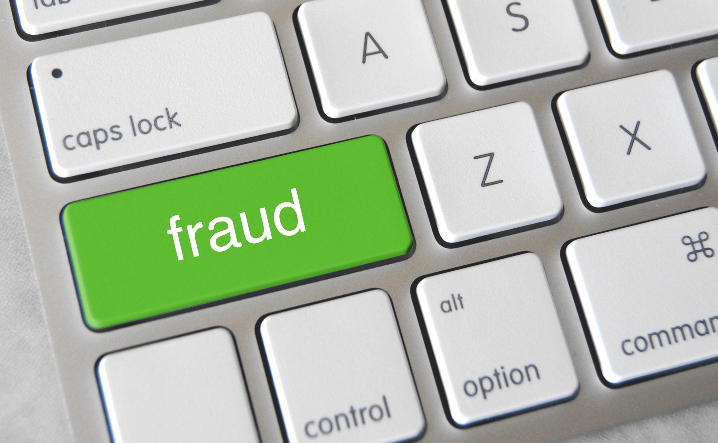 """Green """"fraud"""" key on keyboard"""