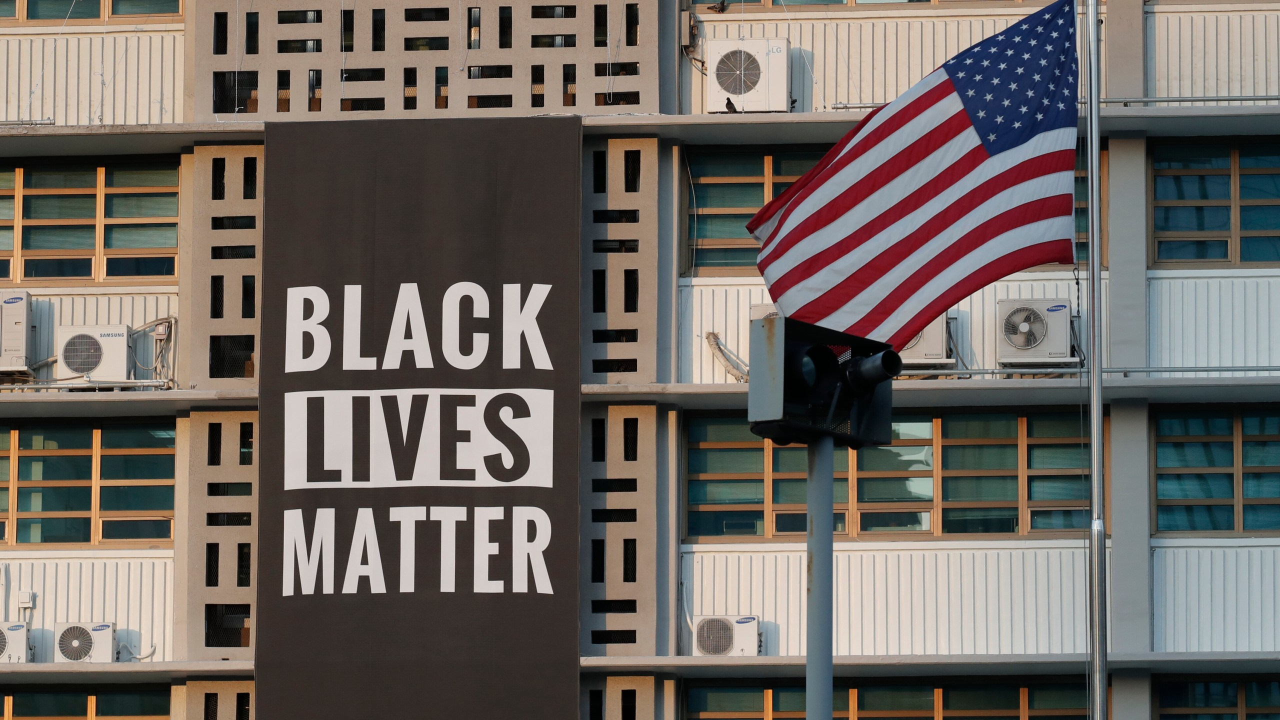 Black Lives Matter sign next to an American Flag