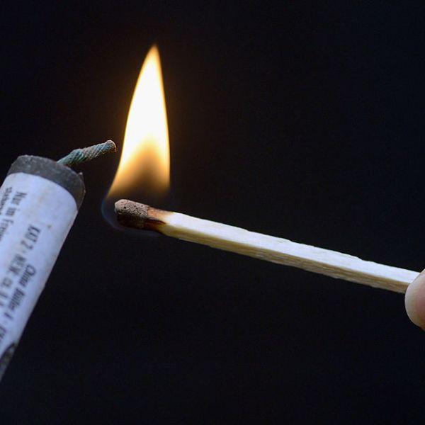 Lighting a firework with a match