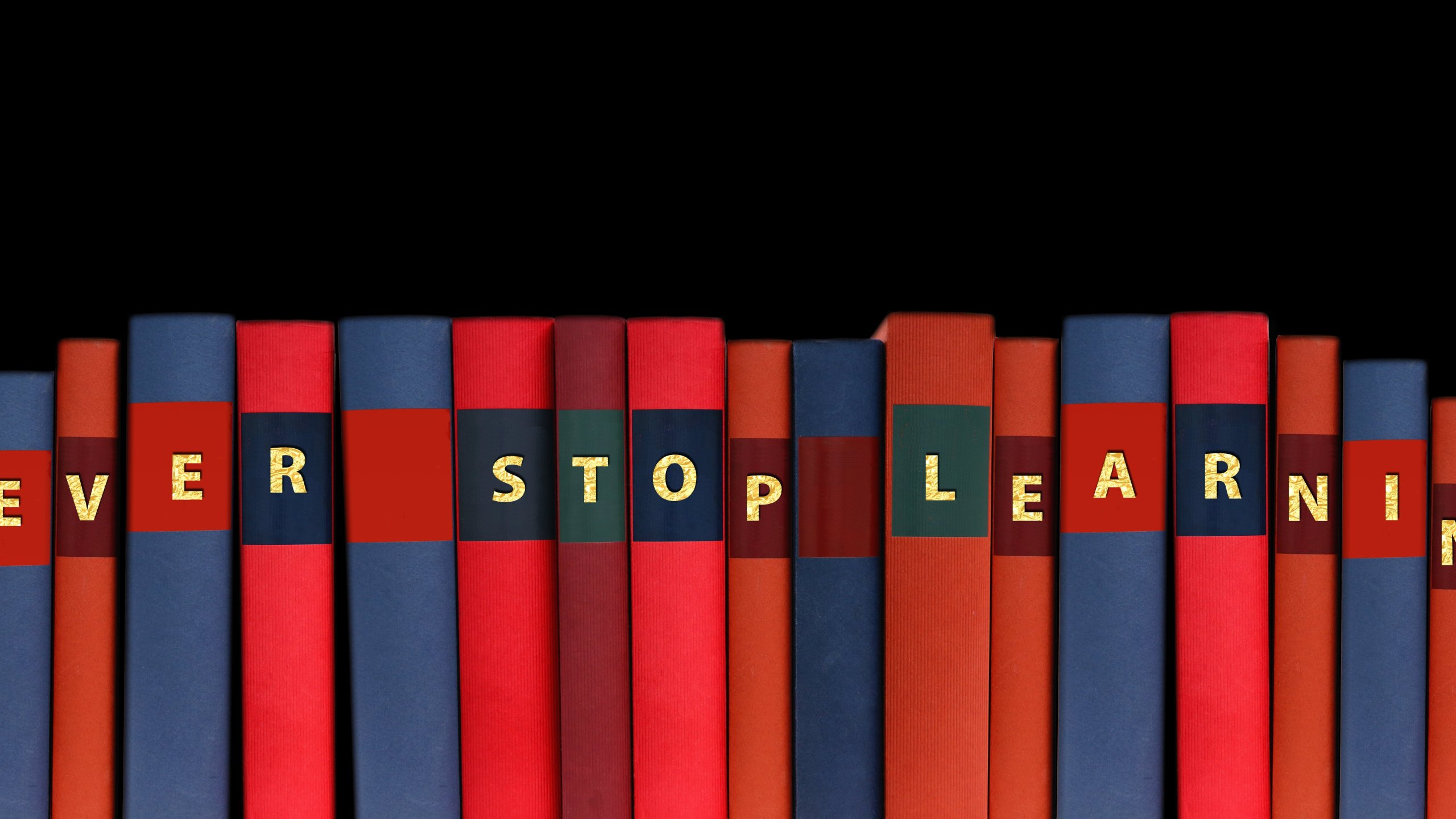 """Never Stop Learning"" on book spines"