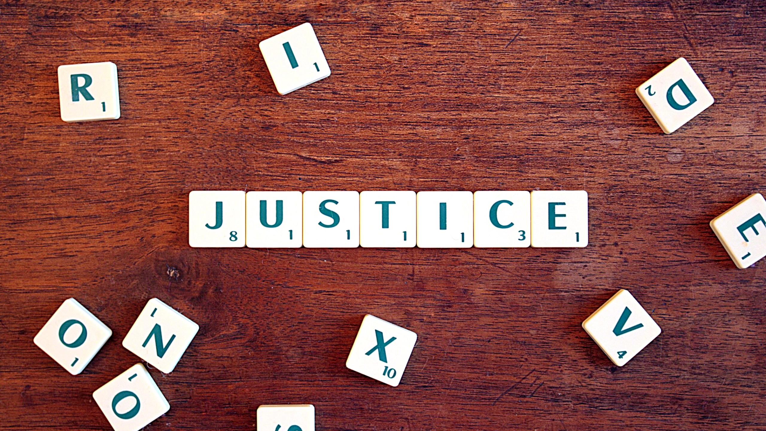 """Justice"" in Scrabble tiles"