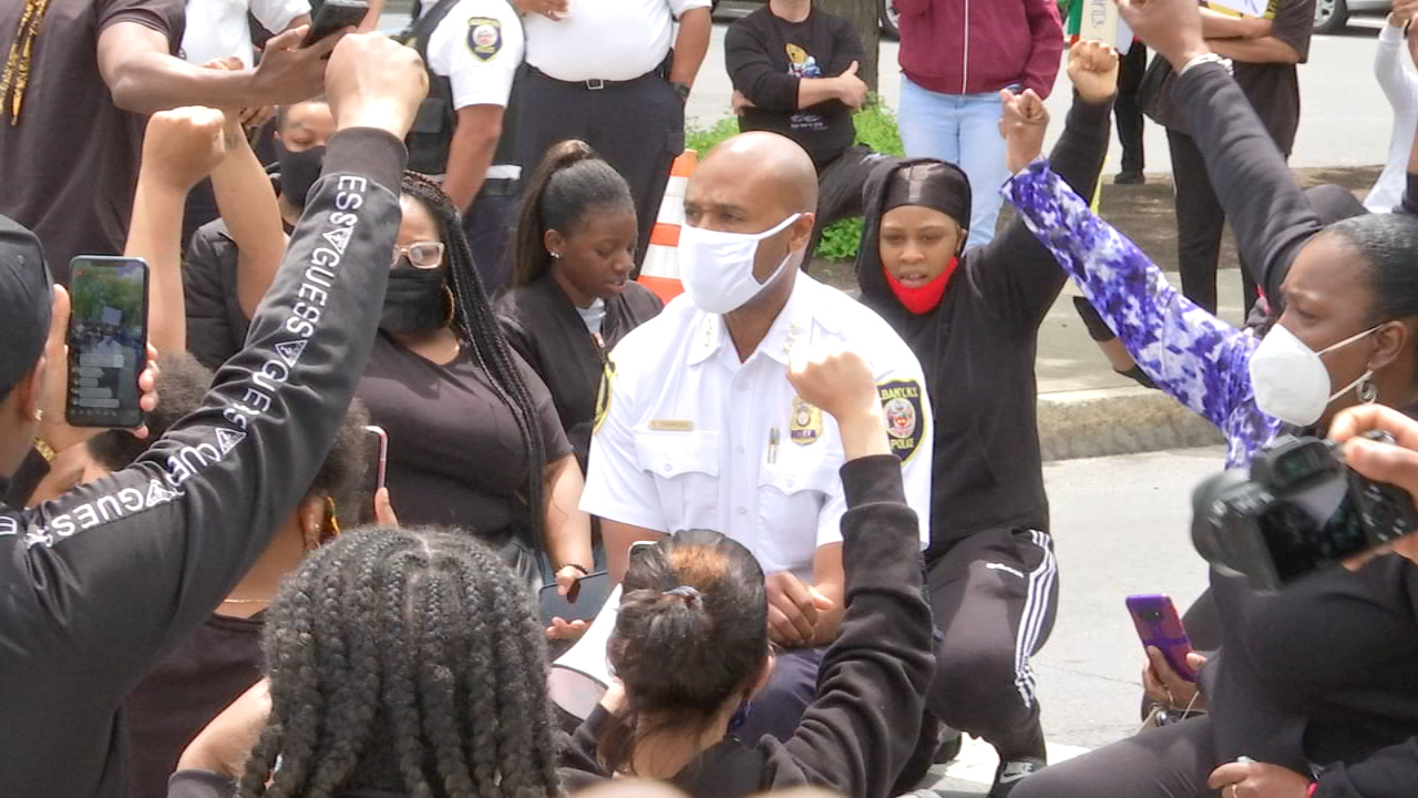 Chief Hawkins kneels with peaceful protestors