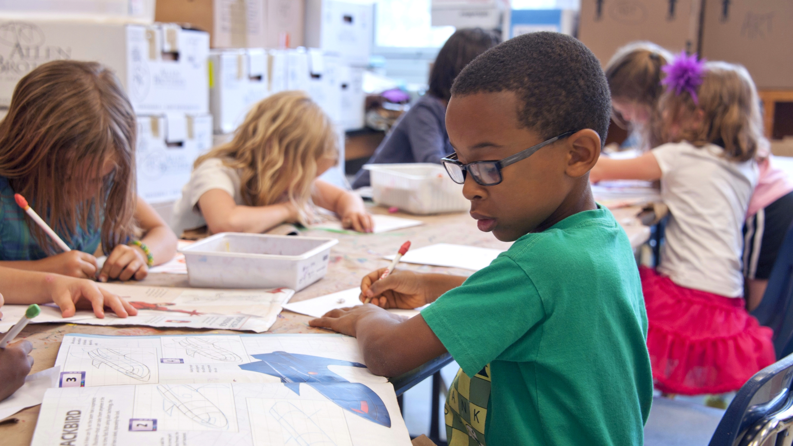 Young student completing classwork