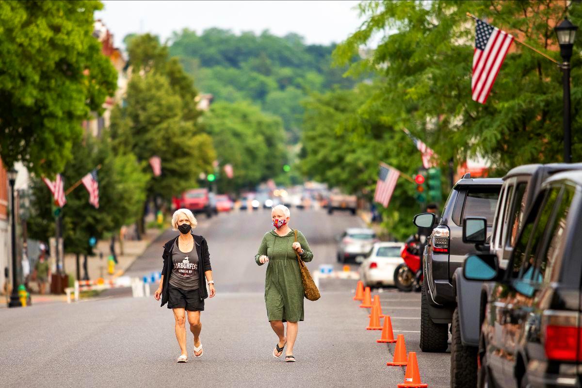 Masked women walking down the street
