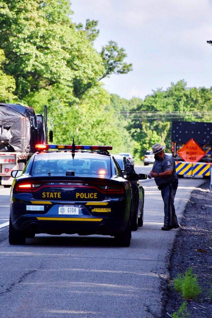 An officer pulls over a car