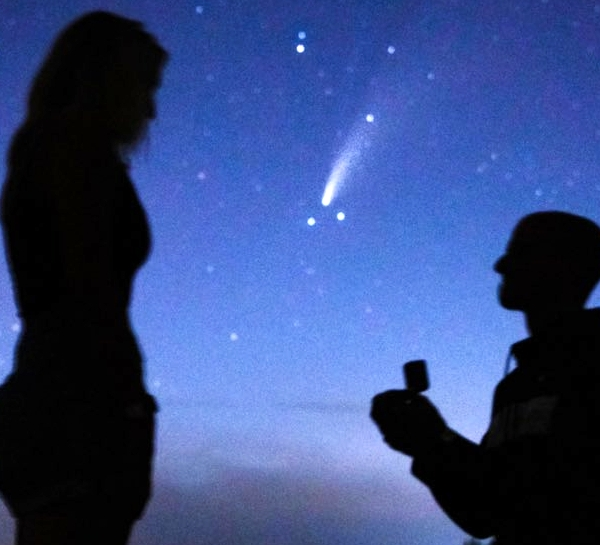 Proposal silhouetted with comet