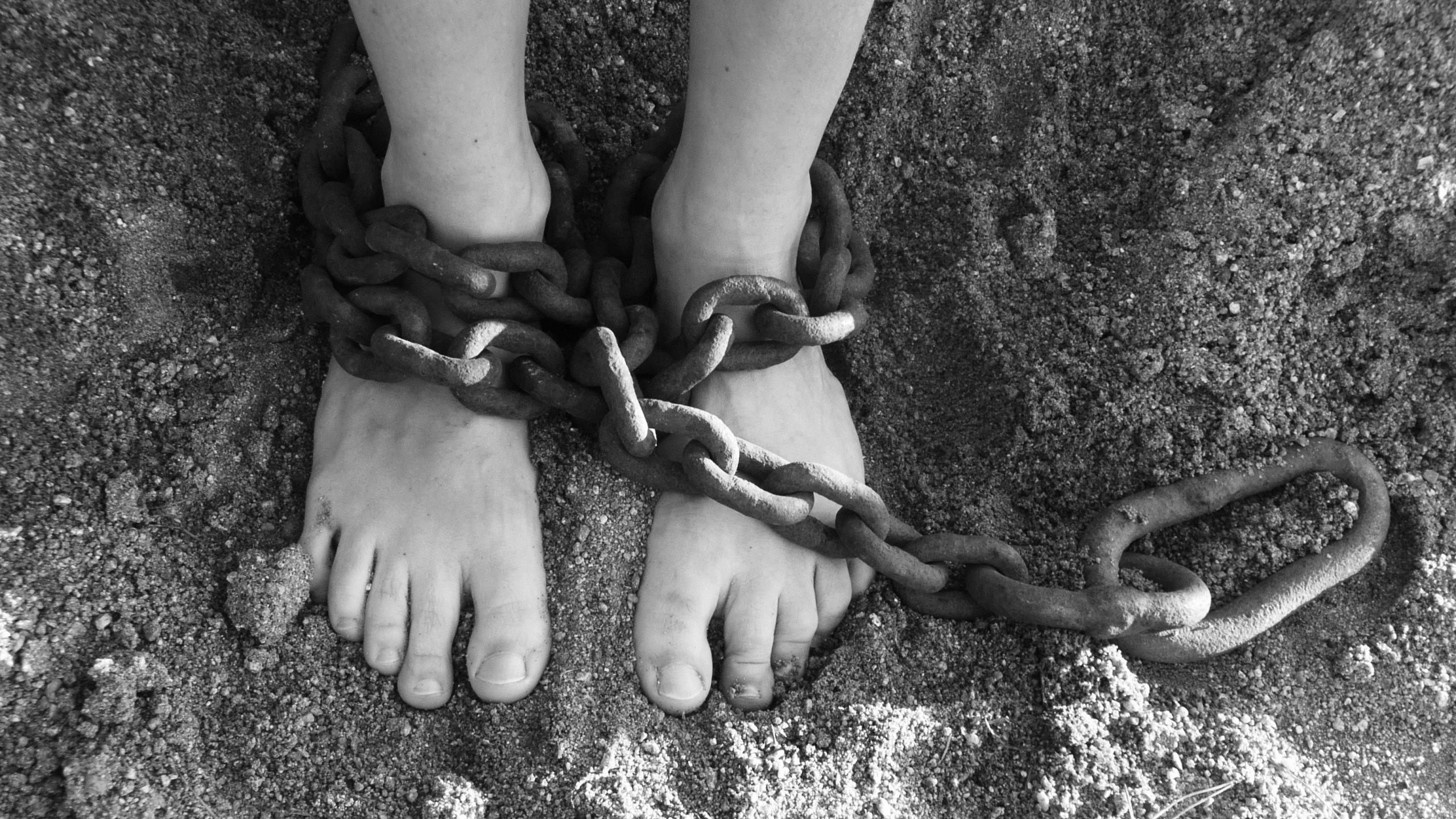 Chained captive feet