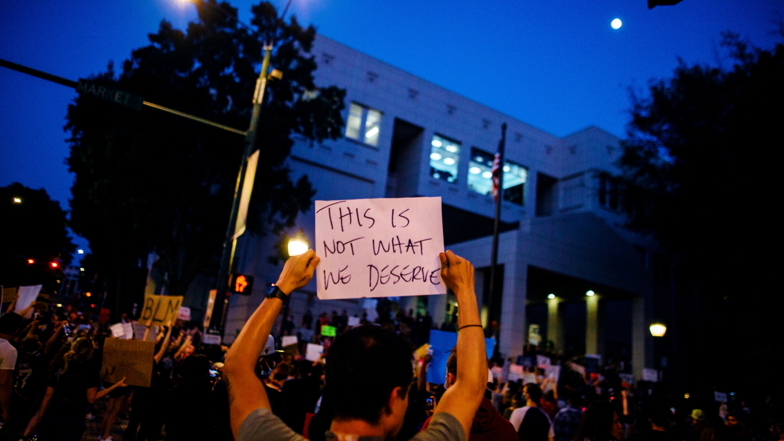 """Black Lives Matter protest sign reads """"This is not what we deserve."""""""