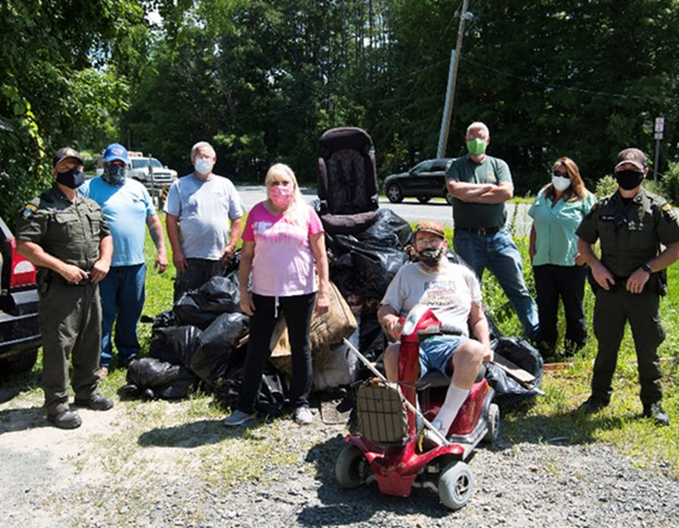 ECOs and volunteers pose with garbage collected near Tomhannock Reservoir