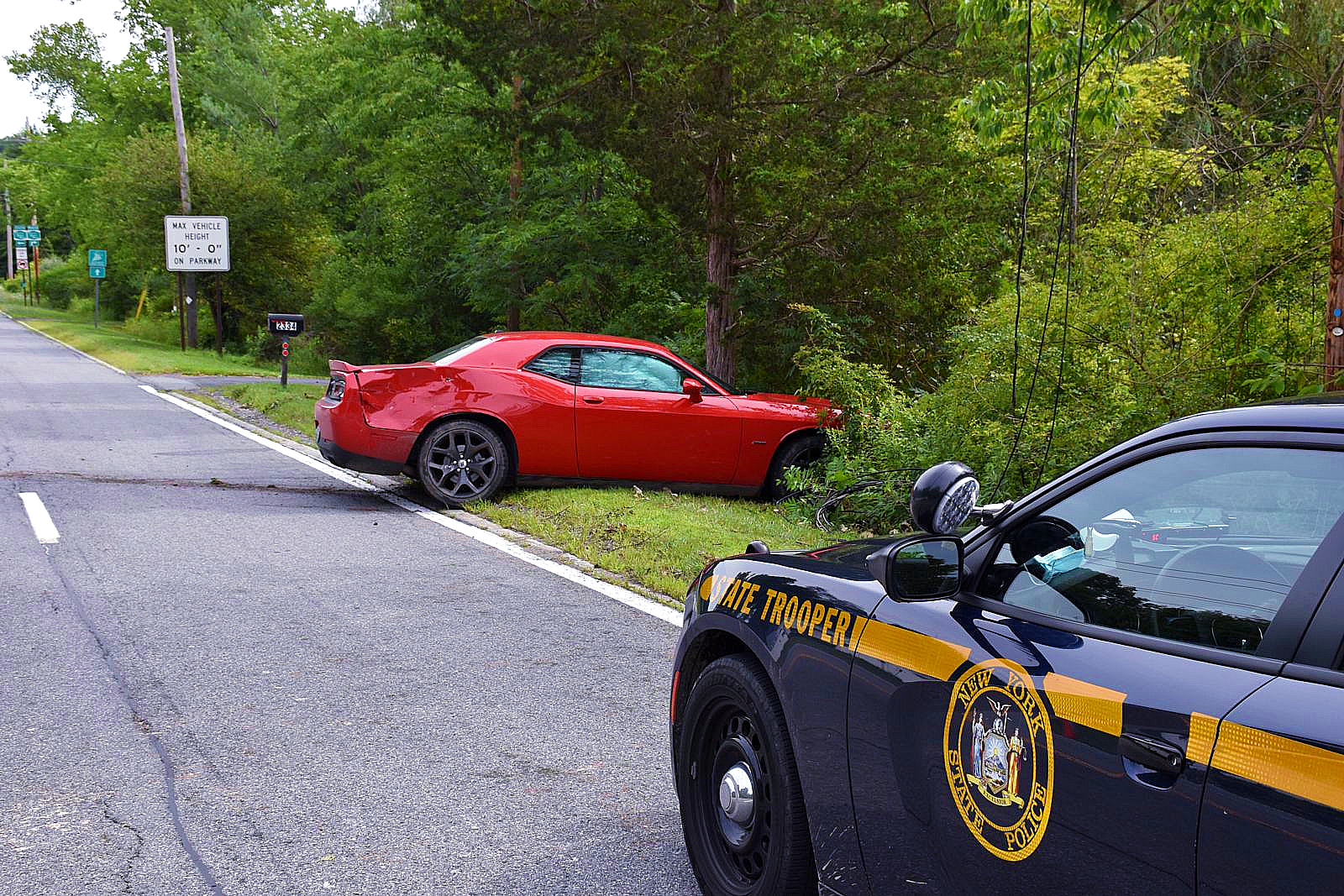 State police on the scene of a collision involving a red car