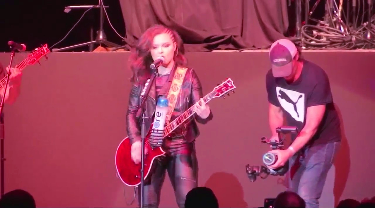 Moriah Formica performing onstage with a guitar