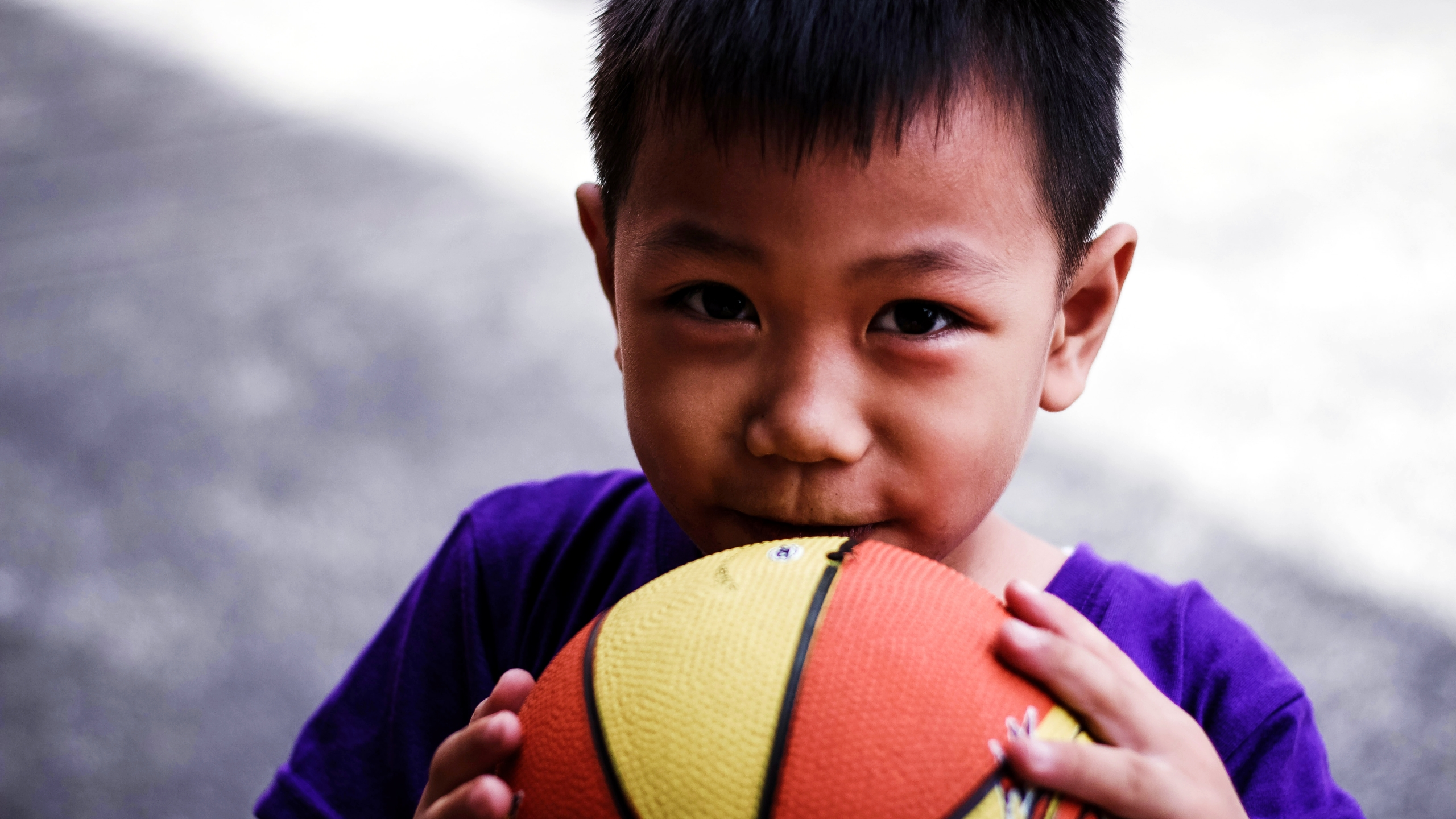 A kid with a basketball