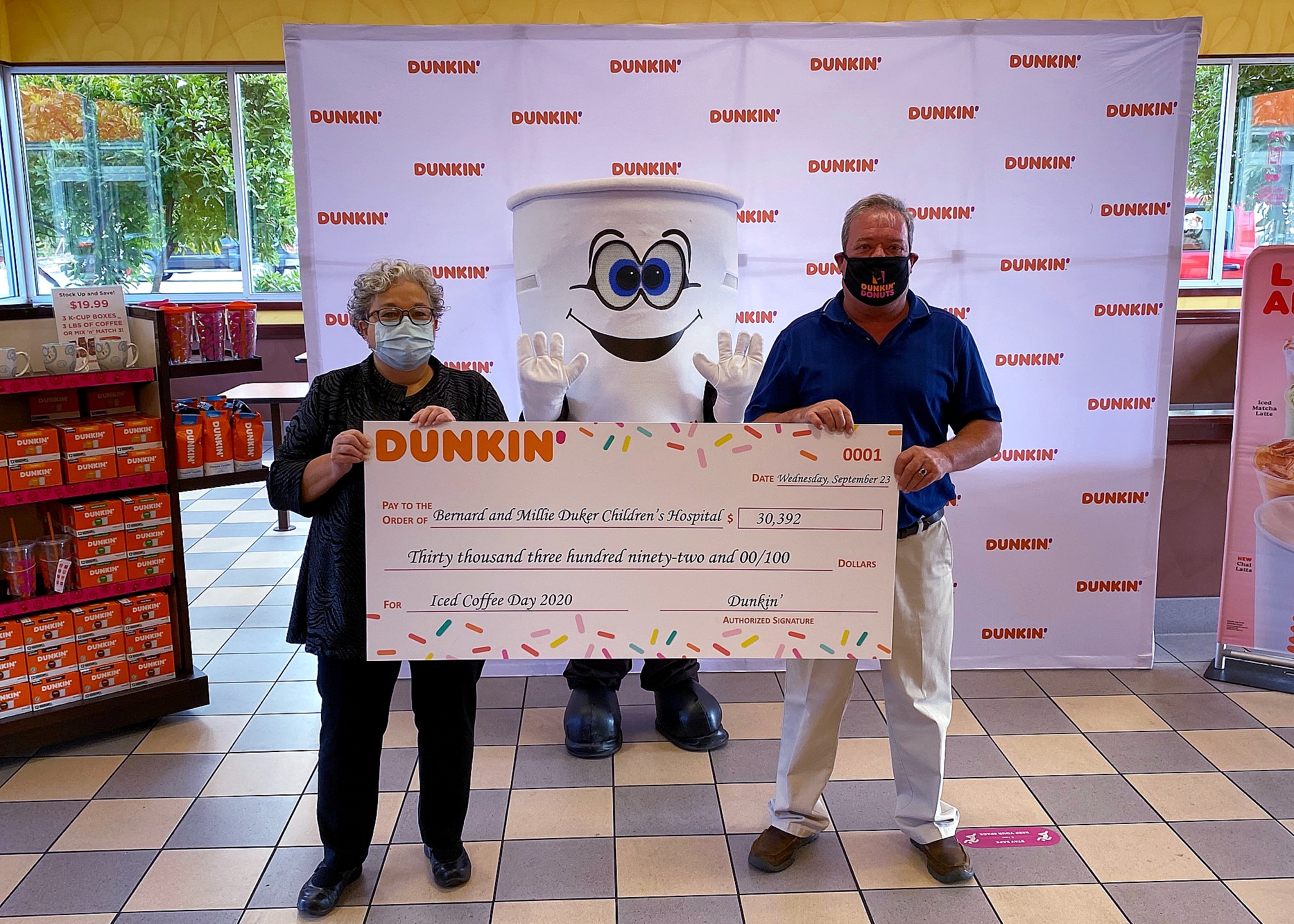 Dunkin' franchisee Ivo Garcia presents a $30,000 donation to Chief of Service at the Bernard & Millie Duker Children's Hospital at Albany Med, Dr. Barbara Ostrov