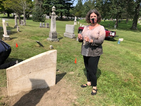 Historian Paula Lamire stands next to Nathaniel Paul's gravesite which she discovered after 150 years buried under sod at Albany Rural Cemetery