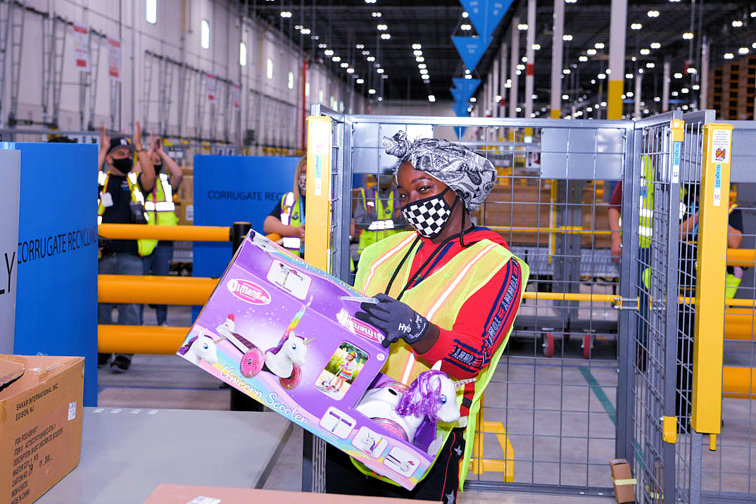 Jamey Higgins received a unicorn scooter as the very first item of inventory in the new Schodack fulfillment center.
