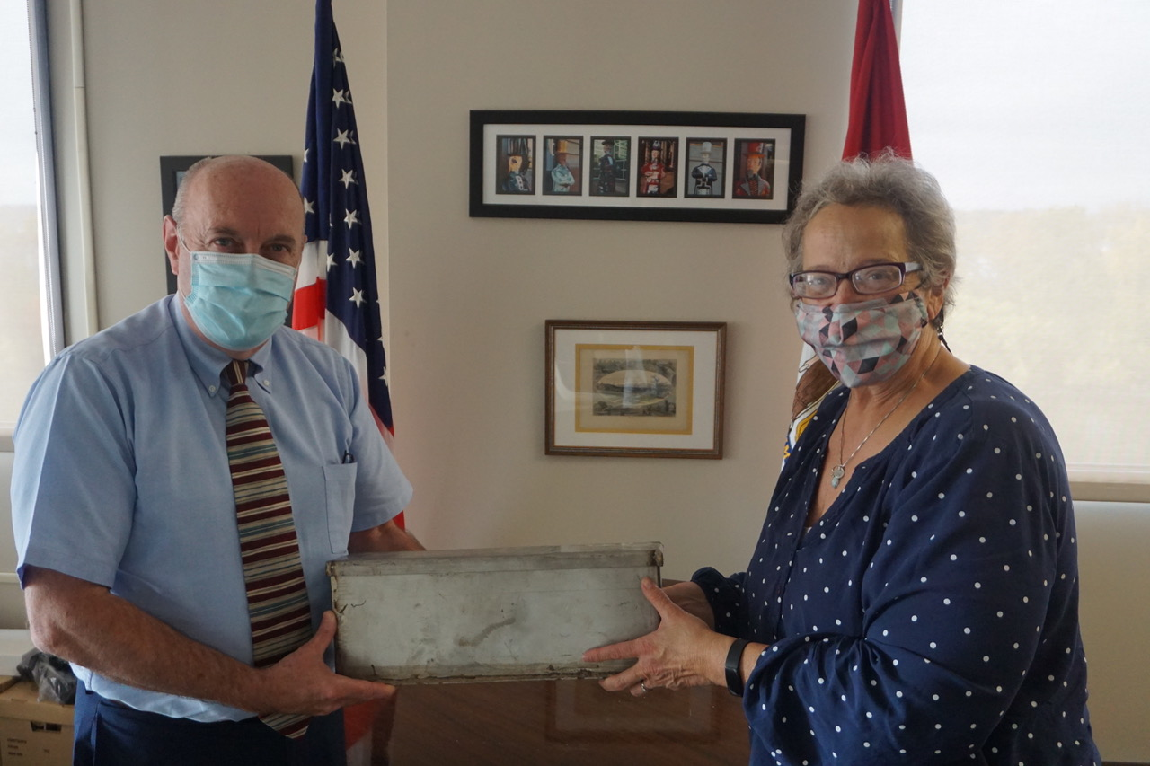 Troy Mayor Patrick Madden and historian Kathy Sheehan with a 1970's-era time capsule