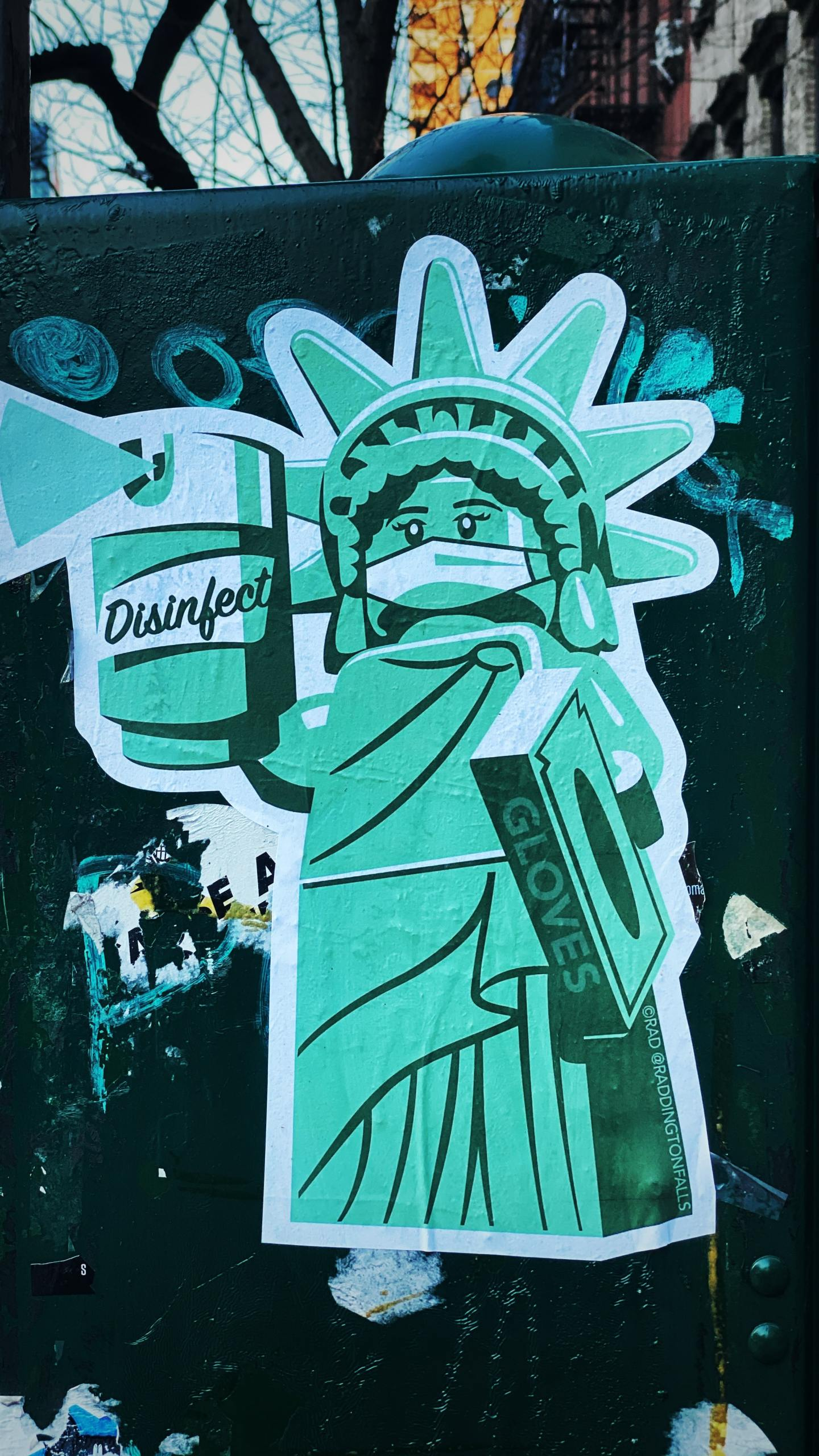 New York City street art featuring a Lego Statue of Liberty in PPE