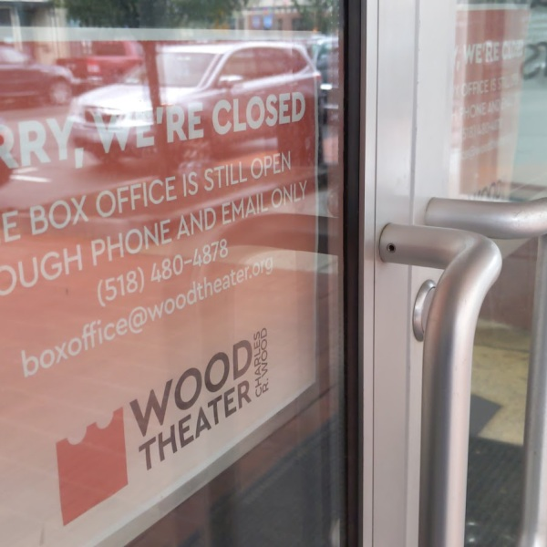 wood theater closed box office sign
