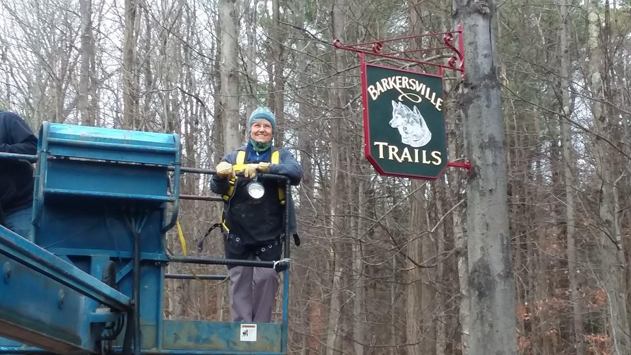 Sign maker Kendra Schieber and sign at Barkersville Trails