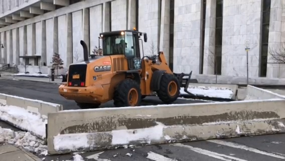 Crews set up barriers on State Street by the NYS Capitol on Thursday following the storming of the U.S. Capitol on Wednesday