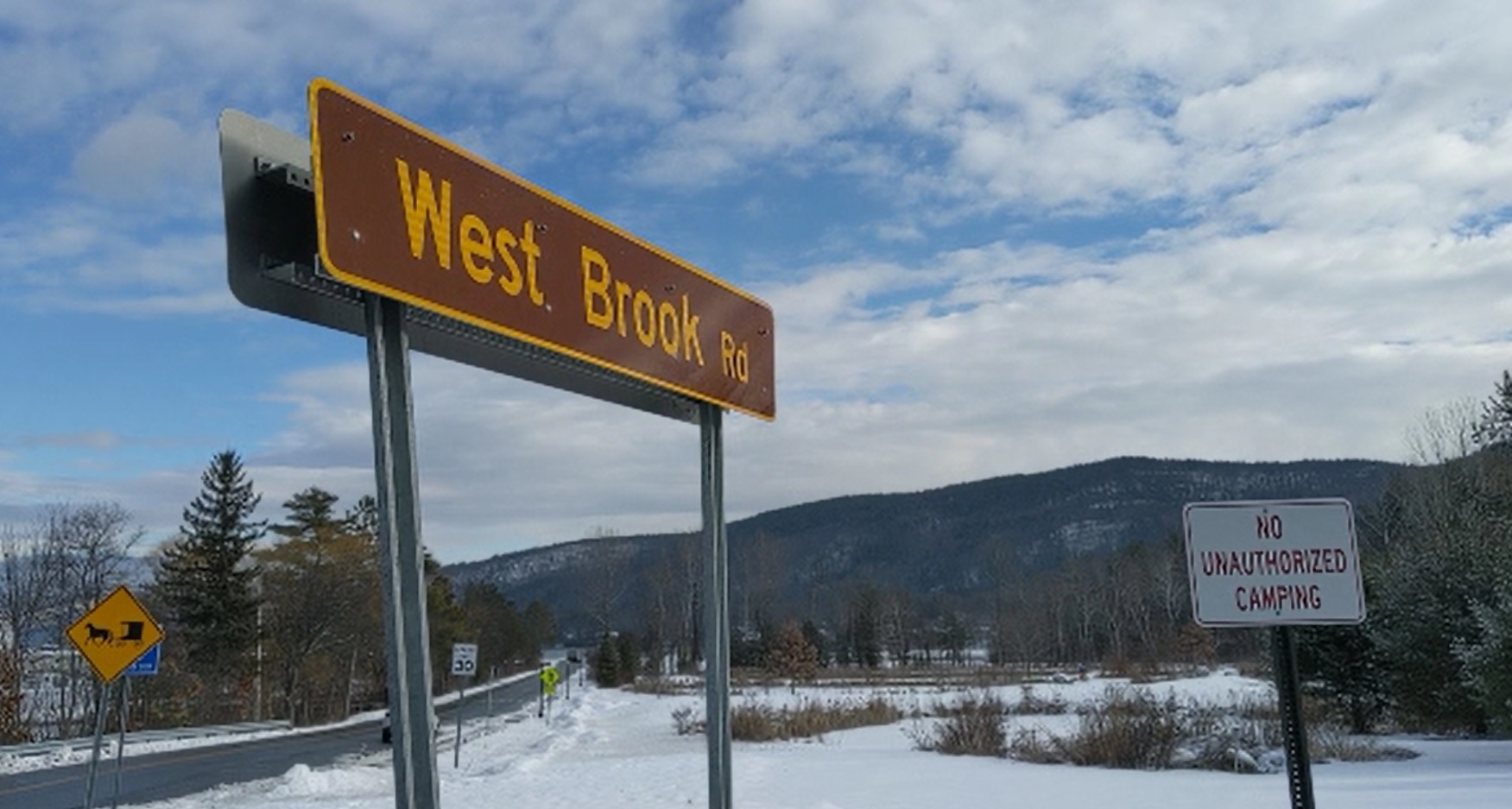 west brook road sign lake george