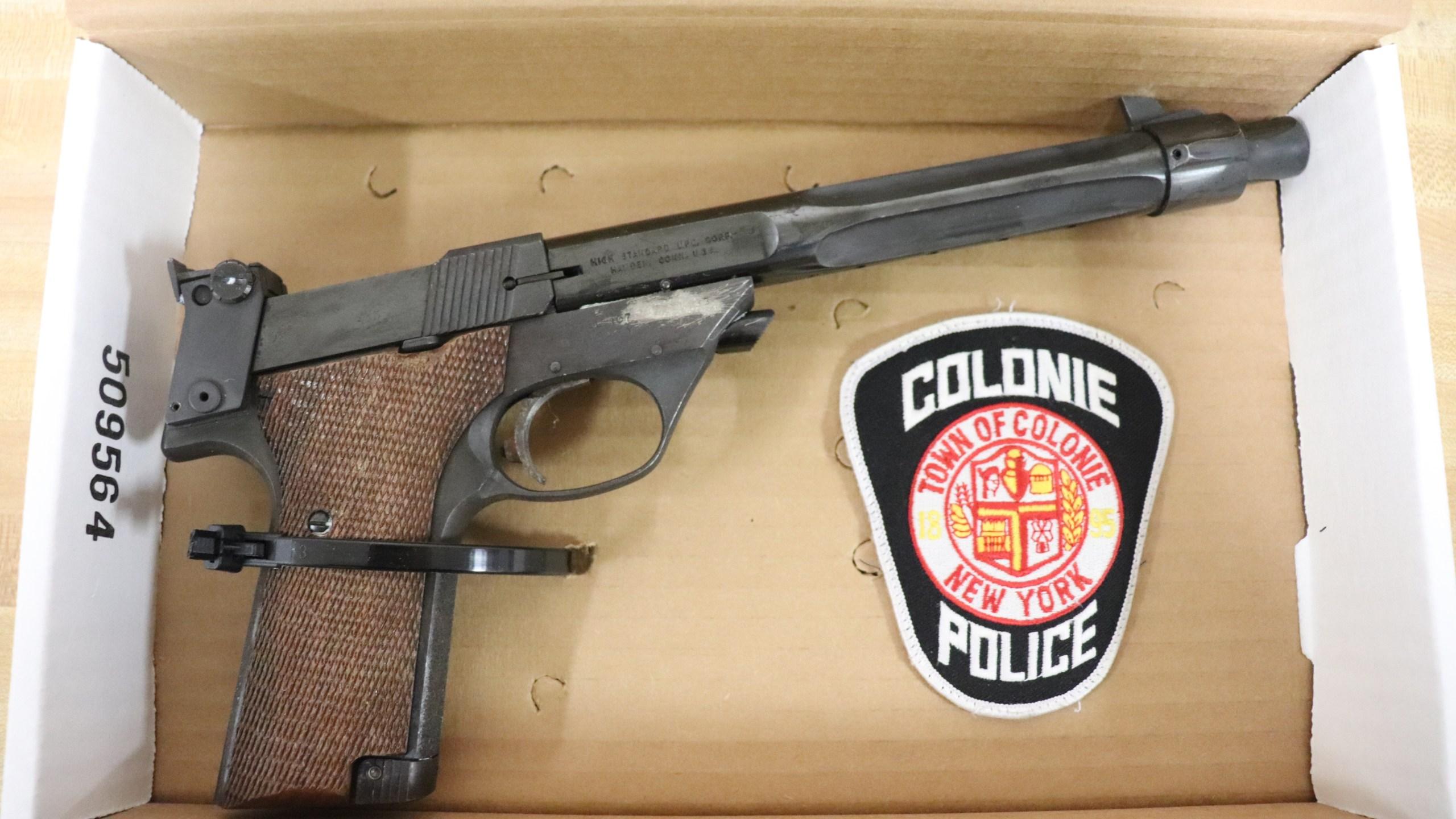 unloaded .22 caliber High Standard Model 107 handgun