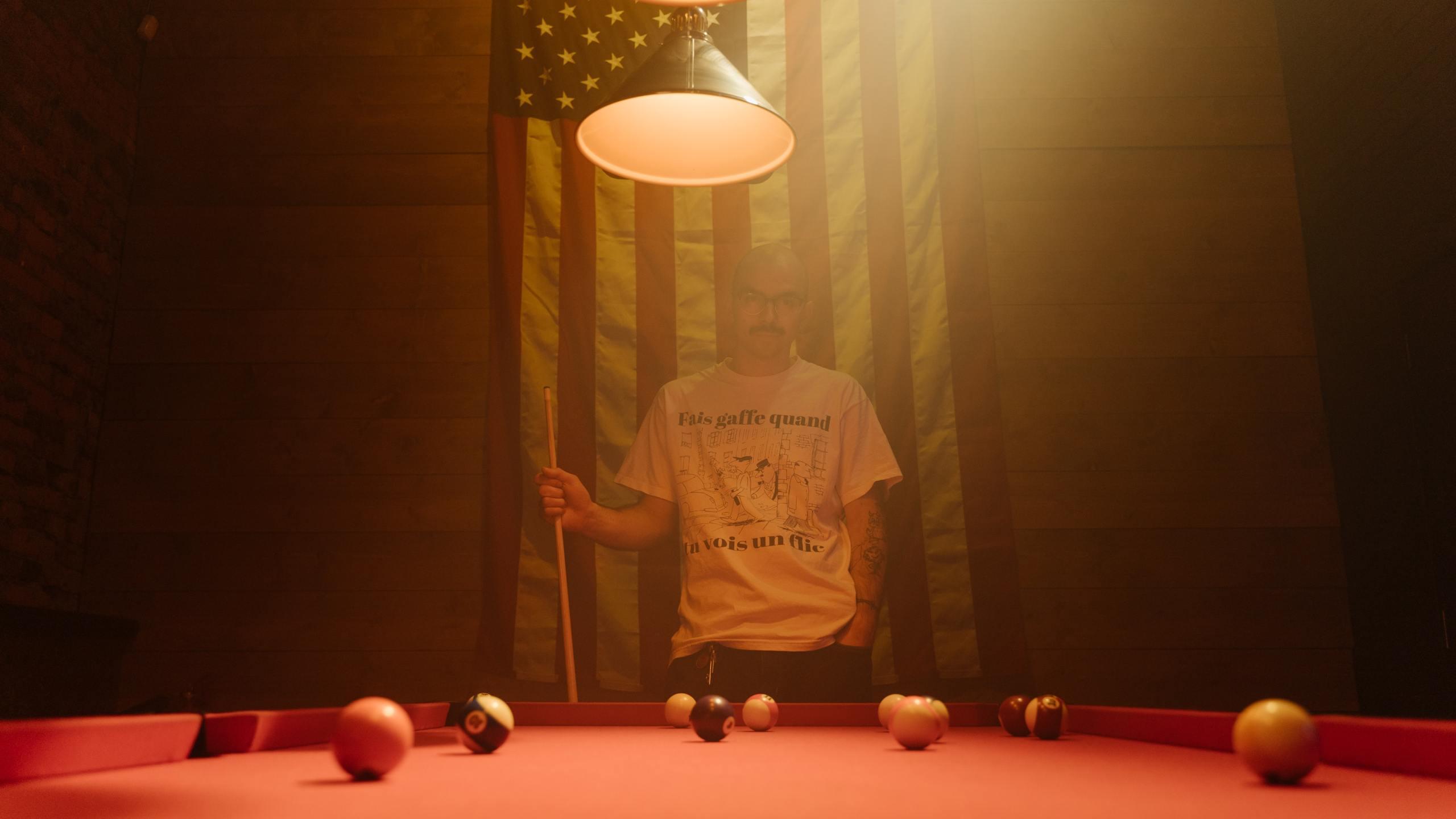 Smokey pool hall. (cottonbro / Pexels)
