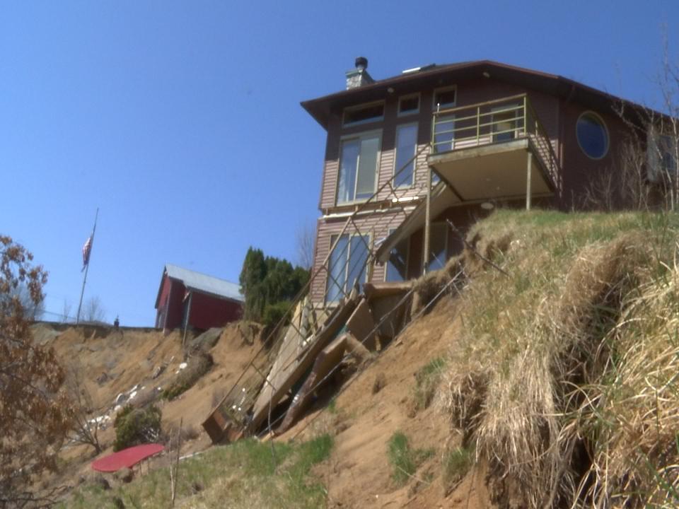 Homeowner facing fines a year after landslide