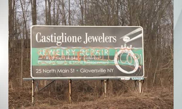Castiglione Jewelers anti-police graffiti billboard