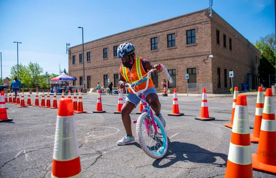 A child riding a bike thorugh an obstacle course at the Albany Police's Bike Rodeo. (Albany Police Department)