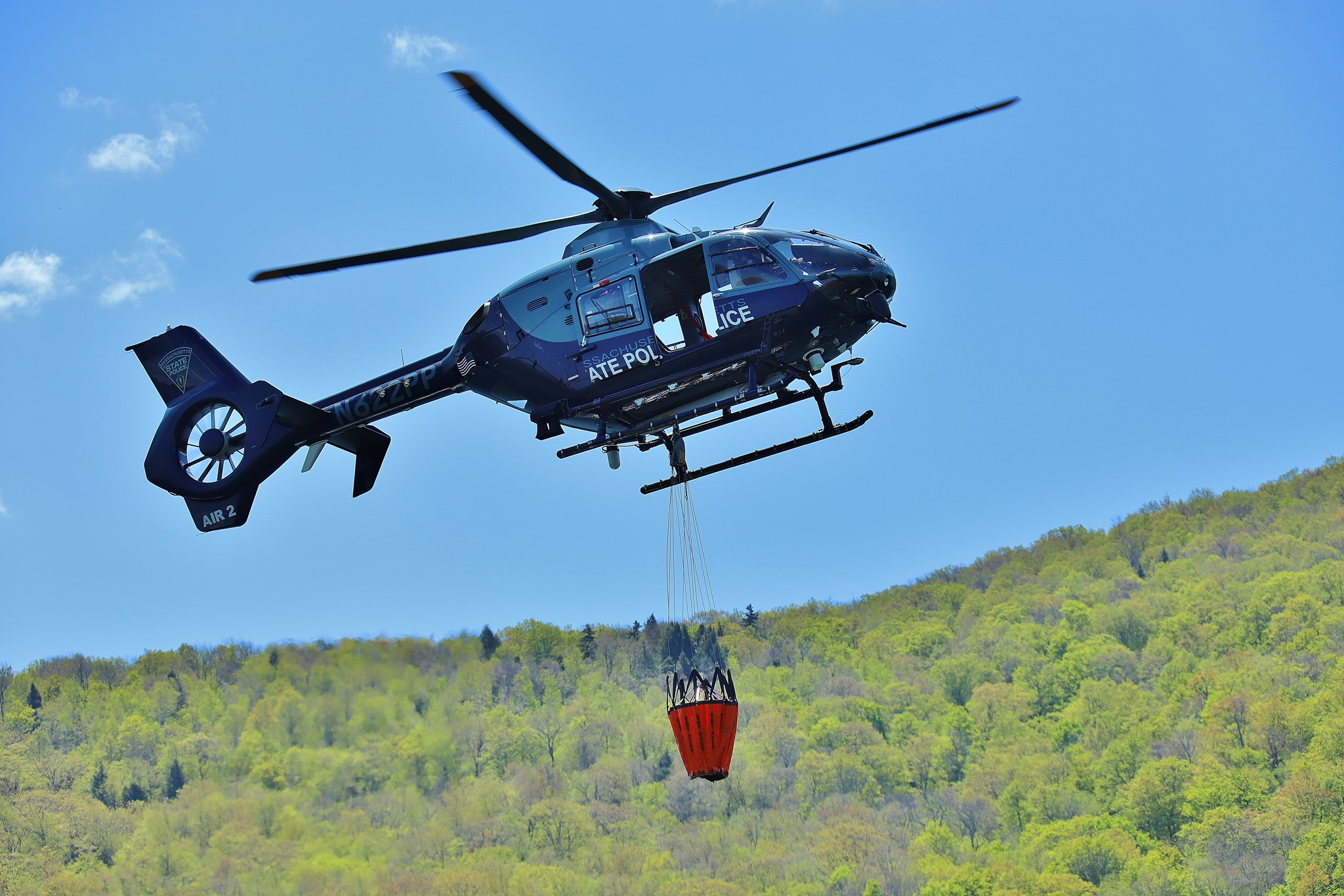 Massachusetts state police helicopter filling bucket from reservoir to fight Williamstown fire (North Adams 911)