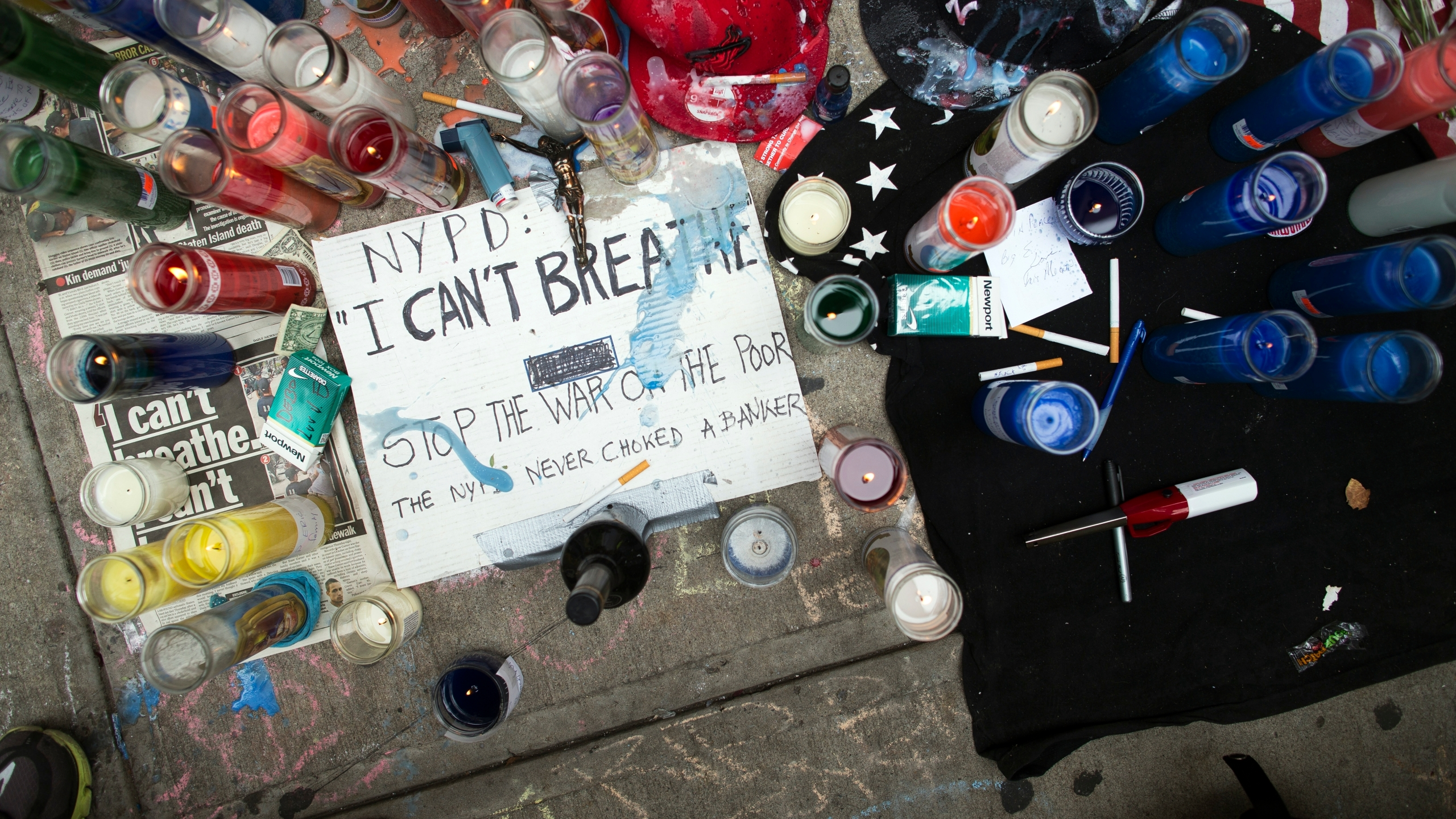 A memorial for Eric Garner rests on the pavement near the site of his death in Staten Island on Saturday, July 19, 2014. (AP/John Minchillo)