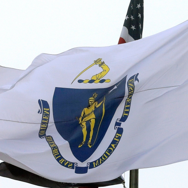 The Massachusetts state flag flies in front of Boston City Hall on Monday, May 2, 2016. (AP Photo/Steven Senne, File)