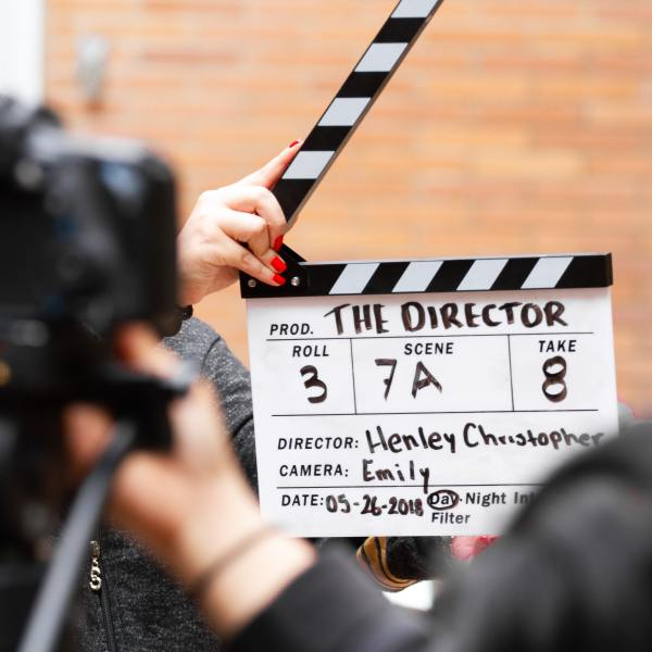 Slate from filming a scene in a movie, show, or commercial. (Martin Lopez / Pexels)